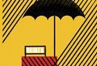 Insurance - umbrella sheltering broker's desk from rain