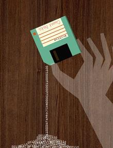 person holding floppy disk