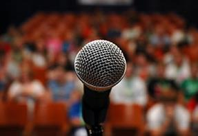 microphone in front of audience 300x207px