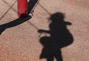 Child on swing image