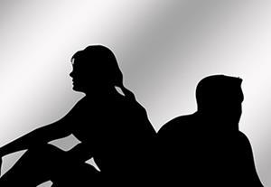 couple looking away from each other 390x234