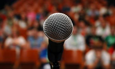microphone in front of audience 390x234