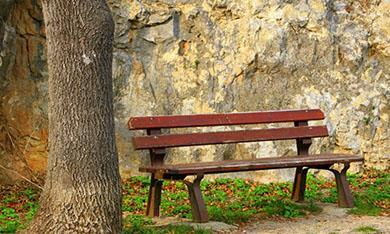 Empty wooden bench - mental health and bereavement