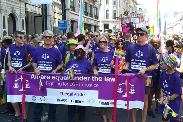 Senior members of the legal profession marching under the banner 'All are equal under the law' for Pride 2018.